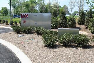 Aesthetically pleasing aluminum enclosure with fire department connection