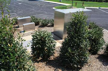three-heated-enclosures-hidden-by-landscaping.jpg