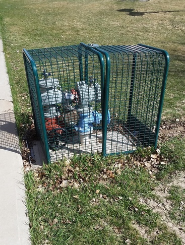 backflow-preventer-cage at a school.jpg