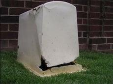 fiberglass-enclosure-weed-eater-damage.jpg
