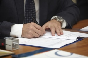 close up of businessman hands signing contract.jpeg