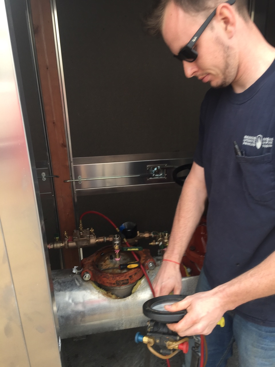 tester working in an aluminum enclosure